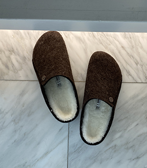 Birkenstock Zermatt Slippers on a bathroom floor