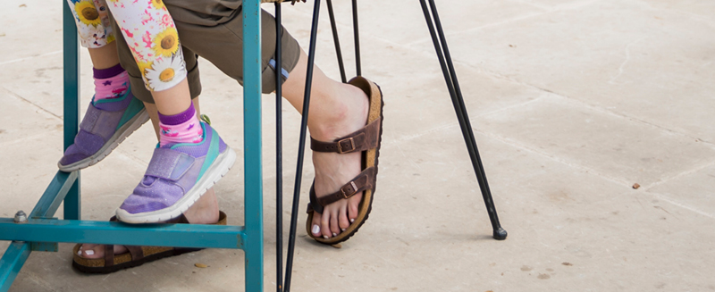 Women's feet wearing Birkenstock sandals