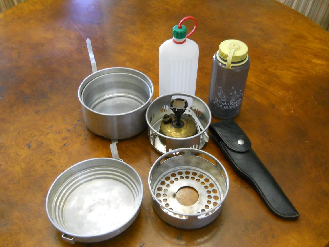 Set of stainless steel camping cookware and water bottles