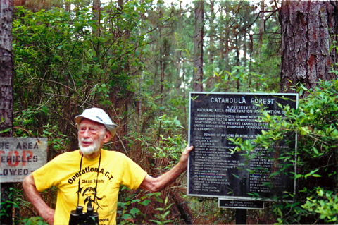 Ned Fritz standing in front of the Catahoula Forest information sign