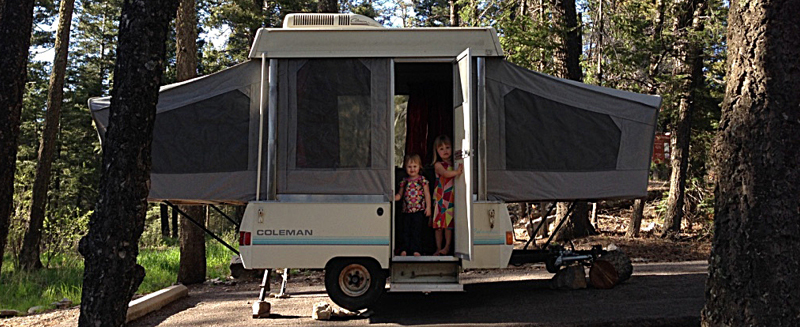 Two kids in a pop up camper.