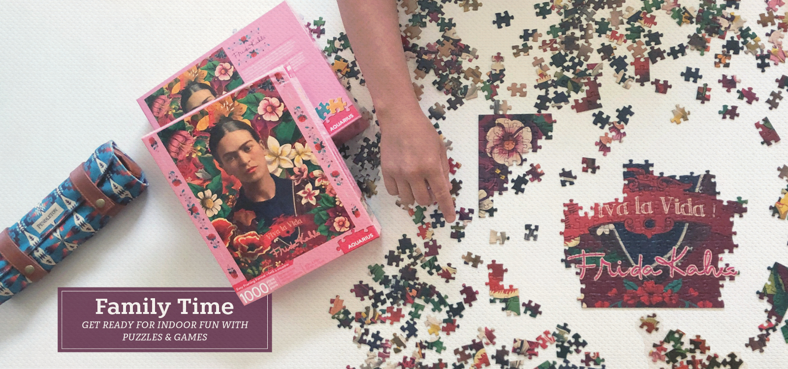 Picture of a half put together puzzle with an image of Frida Khalo. Family Time get ready for indoor fun with puzzles and games