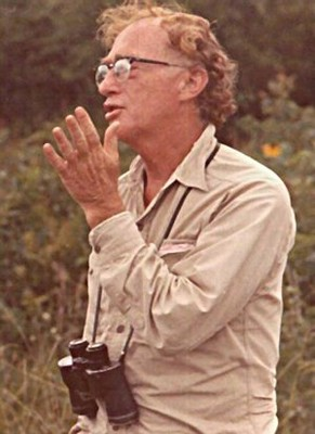 A young Ned Fritz talking and wearing binoculars