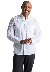 Man standing in a white Exofficio Atoll long sleeve, sun protecting shirt
