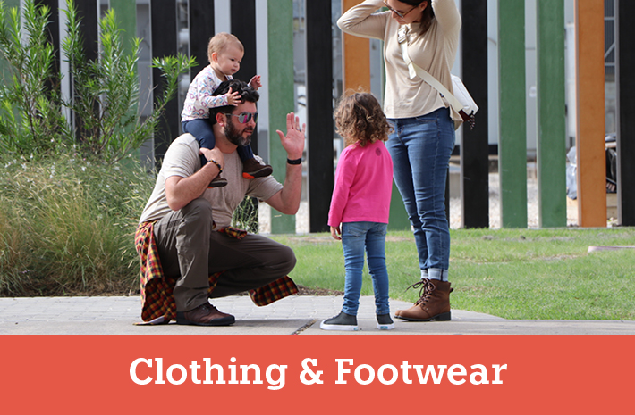 Adults and children at a park wearing casual clothing - View our Clothing and Footwear section