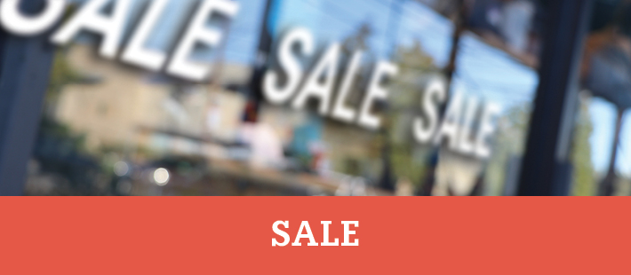Sale signs on a store window - View our Sale products section