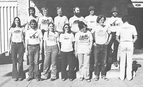 1970's Whole Earth staff posing in Whole Earth T-Shirts
