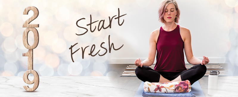 Yogini posing with the words Start Fresh