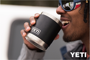 Man with sunglasses drinking from a black Yeti Lowball Mug